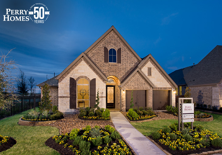 exterior of a one story perry homes model home with beige stone, brown brick, and arched windows with shutters