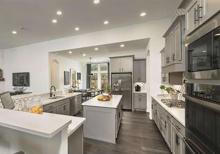 Perry Homes' Design 3578W features white quartz countertops, grey cabinets and stainless-steel appliances