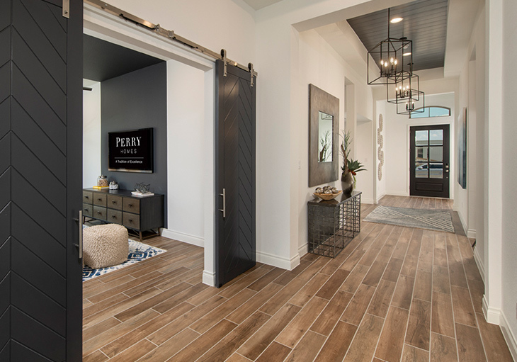 Modern Perry home in Texas with sliding barn doors, earth tones, indoor plants and other interior design trends for 2021