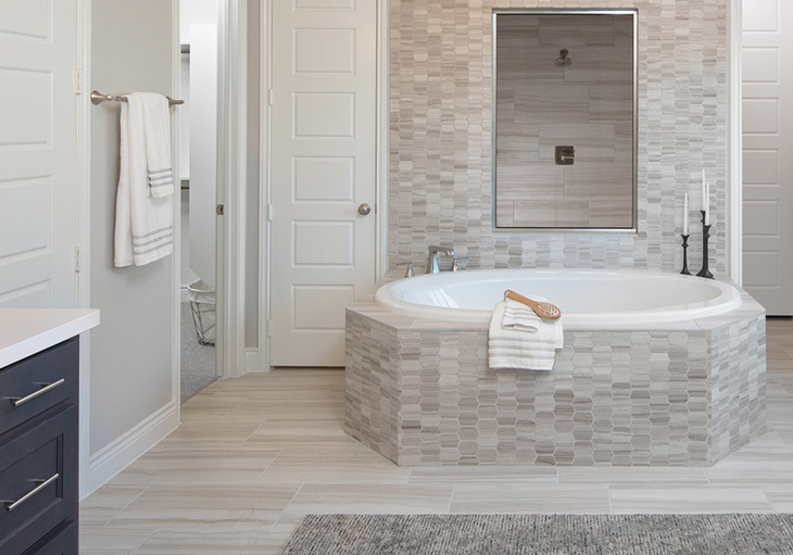A beautiful bathroom features a geometric tile pattern.