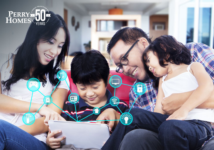 A Mom, Dadm and Kids using a tablet