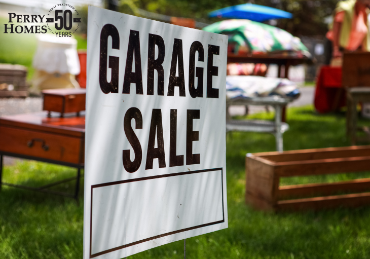 Garage sale sign on the shady lawn of a suburban home, shallow focus in center of sign.