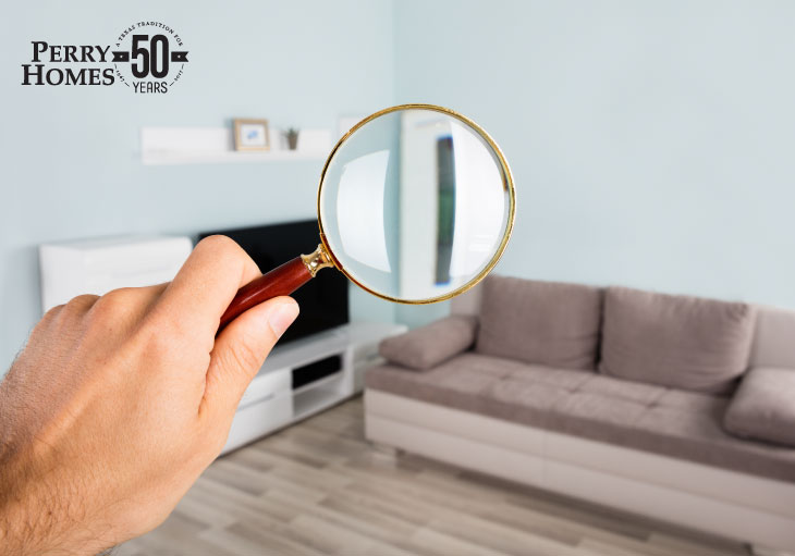 home inspection process - person with a magnifying glass