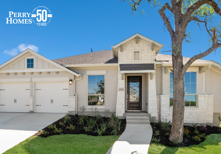 beige one story stucco home with white accent stone, attached two car garage and brown wood glass front door